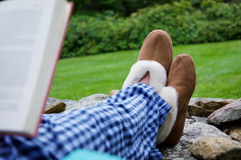 Slippers One Person Low Section Lifestyles Relaxation Leisure Activity Human Leg Real People Sitting Adult Nature Day Human Body Part Body Part Resting Grass Casual Clothing Lying Down Selective Focus Human Foot