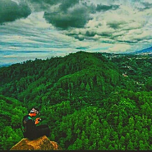 Green mountain Two People Adults Only Adult Sitting Cloud - Sky Mature Adult Helmet Mid Adult People Outdoors Full Length Only Men Mountain Tree Day Headwear Adventure Nature Rural Scene Forest Indoors  Indoors  Indoors  No People Indoors