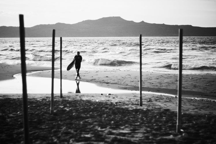 Adventure Beach Beauty In Nature Day Full Length Men Mountain Nature One Man Only One Person Outdoors People Real People Sand Scenics Sea Shore Sky Standing Water Wave The Street Photographer - 2018 EyeEm Awards