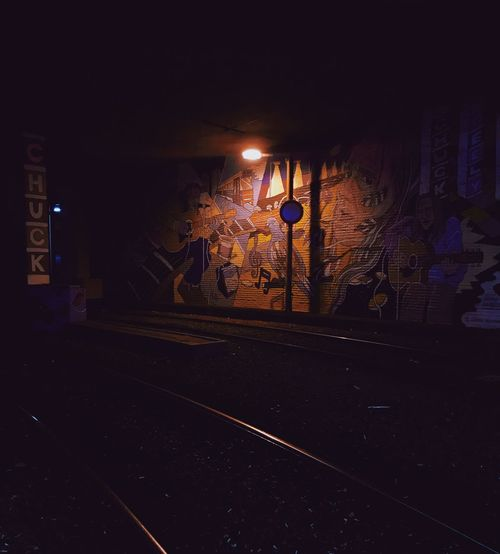 Graffiti Wall Graffiti Streetart Streetphotography Night Illuminated Street City Road Architecture Building Exterior Transportation Outdoors Lighting Equipment Sign Street Light No People