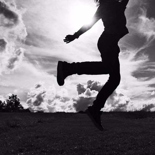 Low angle view of girl jumping in mid-air