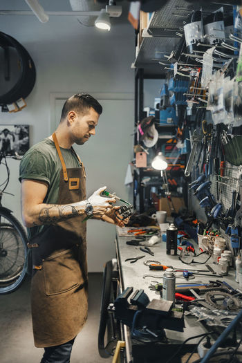 Man working with bicycle