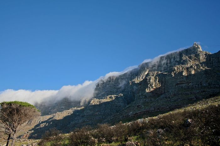 Beauty In Nature Blue Cape Town Beauty Clear Sky Clouds Copy Space Day Geology Idyllic Landscape Majestic Mountain Mountain Range Nature Non-urban Scene Physical Geography Remote Rocky Mountains Scenics Sky South Africa Is Amazing Surfin Table Mountain Tranquil Scene Tranquility