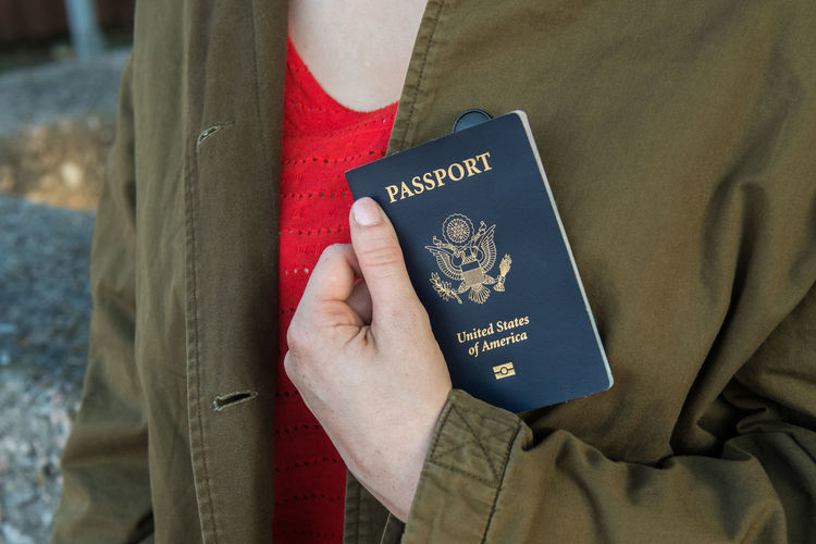 Passport Close-up Human Body Part Human Hand Midsection One Person Passport Text Travel