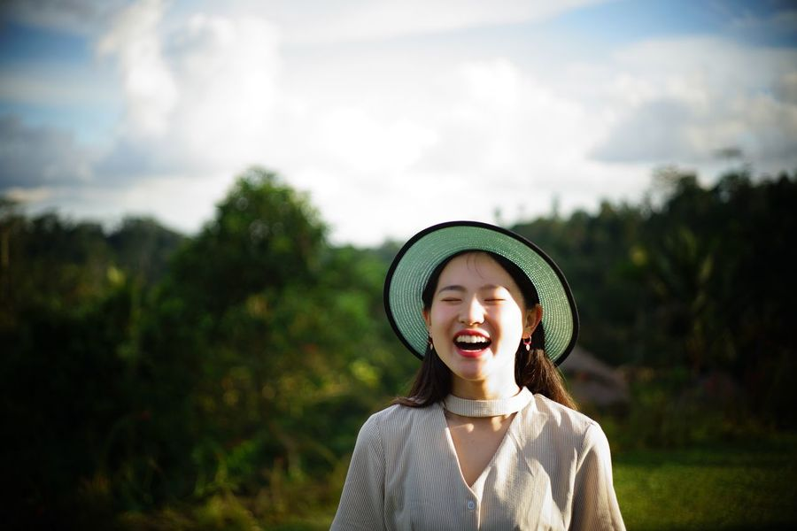 One Person Mouth Open Front View Leisure Activity Focus On Foreground Real People Casual Clothing Outdoors Day Lifestyles Young Adult Young Women Standing Sky Nature Women Happiness Portrait Human Body Part Tree Summer Exploratorium