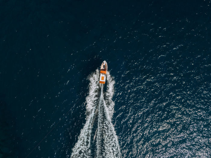 Water Motion Nautical Vessel Transportation Nature Sea Day High Angle View Speed Wake - Water Wave Pattern Sport One Person Outdoors Unrecognizable Person Mode Of Transportation Direction Beauty In Nature