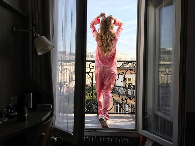 Girl on balcony Pink Pijamas Parisian View Balcony Indoors  Window Home Interior One Person Full Length Domestic Life Lifestyles Looking Through Window Young Adult Blond Hair Real People Beautiful Woman Young Women One Woman Only Women Day Bedroom