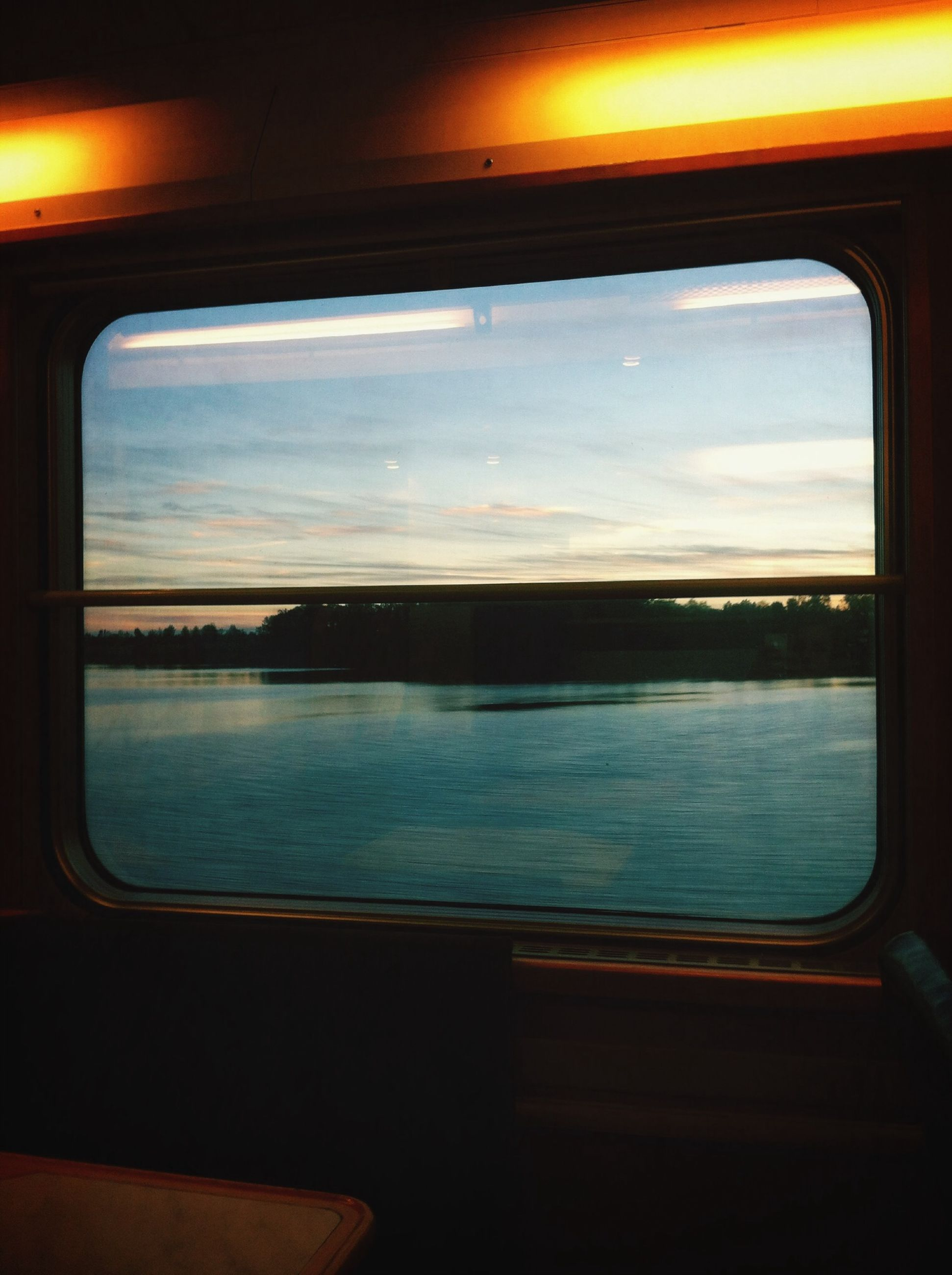 transportation, vehicle interior, window, mode of transport, sunset, transparent, indoors, glass - material, water, sky, sea, travel, reflection, journey, scenics, looking through window, nautical vessel, nature, car, airplane