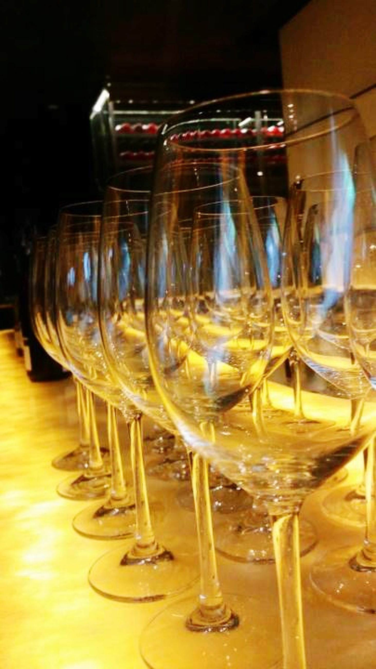 indoors, wineglass, glass - material, drinking glass, transparent, still life, alcohol, close-up, table, wine, drink, refreshment, wine glass, illuminated, food and drink, glass, red wine, bottle, champagne, focus on foreground