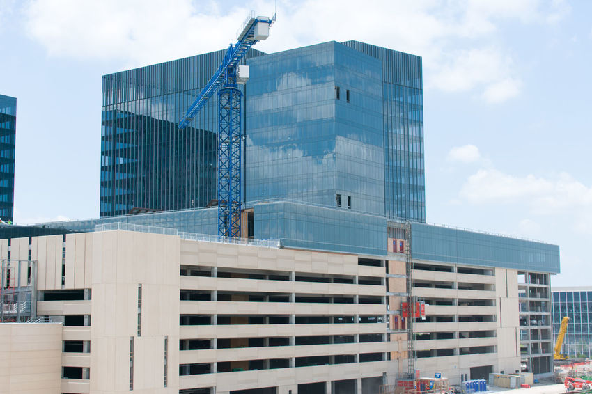 EyeEm SelectsConstruction site in The Colony,TX,USA Skyscraper City Business Finance And Industry Architecture Sky Outdoors Building Exterior No People Urban Skyline Day Cityscape Water