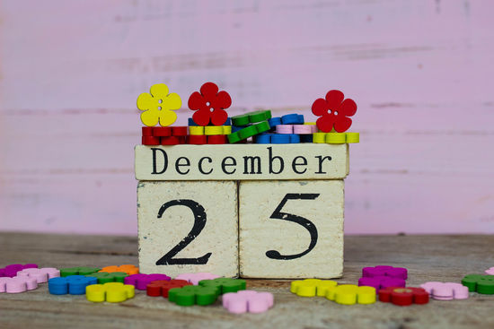 Wooden calendar show date of December 25 with colorful wooden flowers 2⃣5⃣ Backgrounds Celebration Christmas Close-up Date Day December Growth Multi Colored Outdoors Red Wood Wood - Material Wooden Wooden Flower Yellow