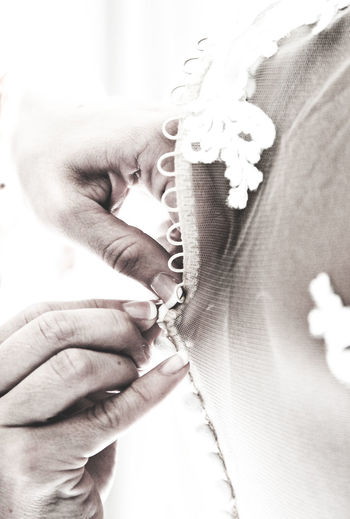 Human Hand Human Body Part Holding Close-up Wedding Wedding Dress Wedding Photography Button Buttons Button Up Lace Lace - Textile Fabric Fabric Detail Friendship Family Closeness Wedding Ceremony Bride Weddings Dress Weddings Around The World Waiting Working Occupation The Week On EyeEm Business Stories Visual Creativity