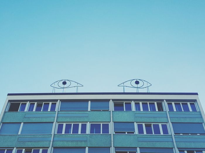 Geneva has its own eyes Clear Sky Blue Building Exterior Architecture Low Angle View No People Sky City Day Outdoors Architecture_collection Architecture Architecturelovers GREAT GATSBY EyeEm Best Shots Wanderlust Europe Landmark Photooftheday Photography Travel View Travel Destinations Building Eyes