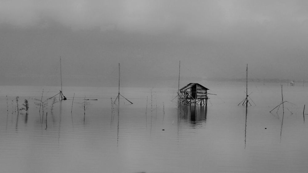 under the fog at the Kerinci Lake Lake View Water Reflection Sky