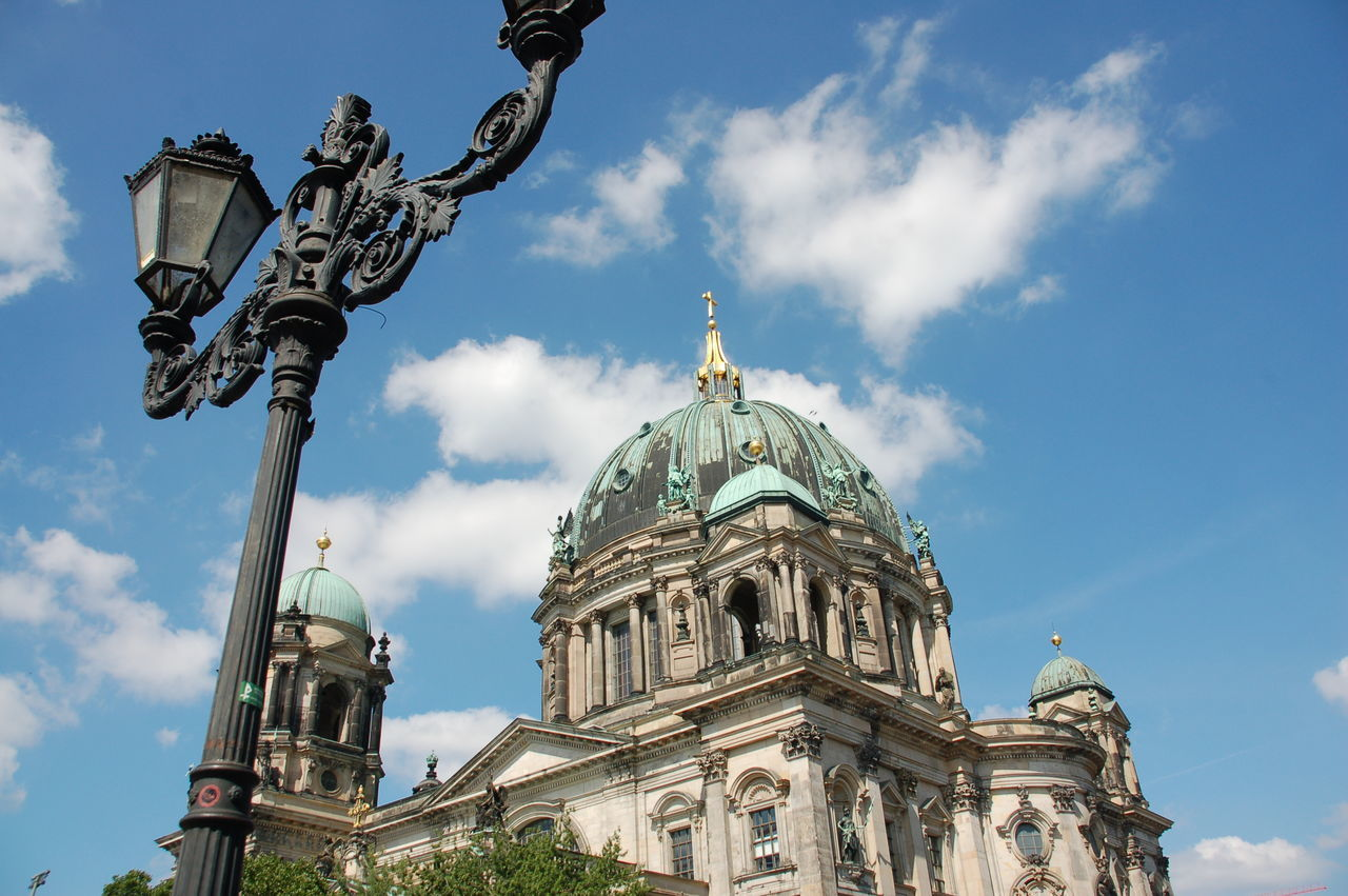 Low Angle View Of Antique Gas Light By Berlin Cathedral Against Sky