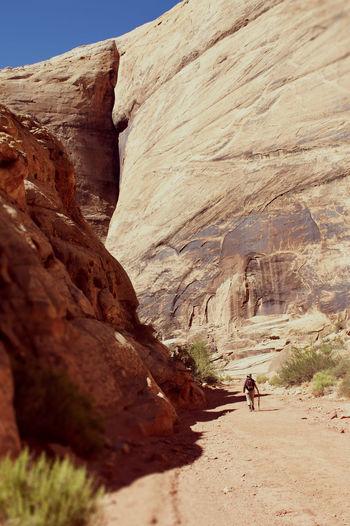 Tourist walking through a canyon