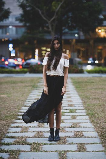 Full length of woman on street in city