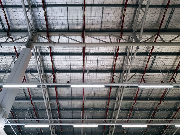 Low angle view of illuminated warehouse structure