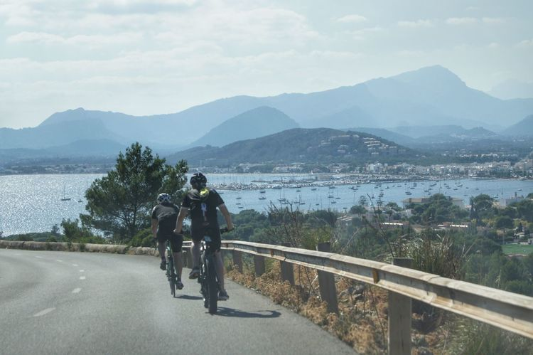Cap Formentor Mallorca Road Vacations Beauty In Nature Bicycle Cycling Day Full Length Helmet Men Mountain Mountain Range Nature Outdoors People Real People Rear View Road Scenics Sky Sport Transportation Tree Water