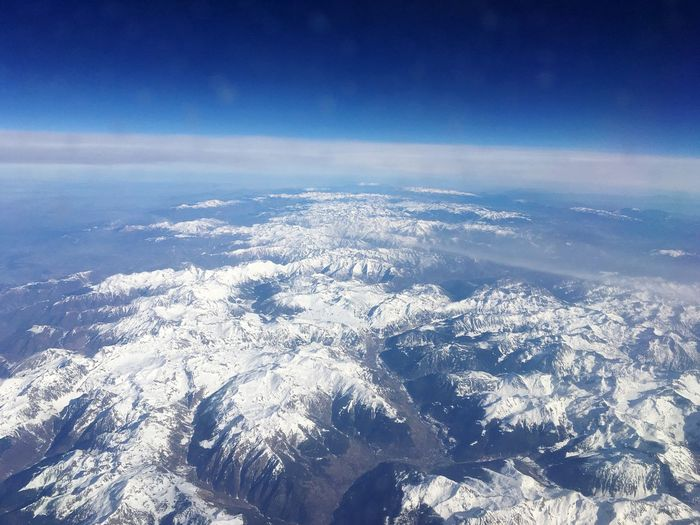 Aerial shot of snow capped mountains EyeEm Selects Sky Aerial View Cloud - Sky Scenics - Nature Beauty In Nature Nature Tranquility Tranquil Scene Blue No People Idyllic Day Environment Outdoors Sea Land Landscape Cloudscape Water High Angle View