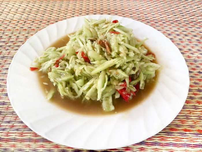 Spicy cucumber salad, Thai food Street Food Worldwide Local Salad Thai Food Spicy Food Cucumber Plate Table Indoors  Food And Drink Food Still Life Tablecloth Healthy Eating Freshness Ready-to-eat Indulgence