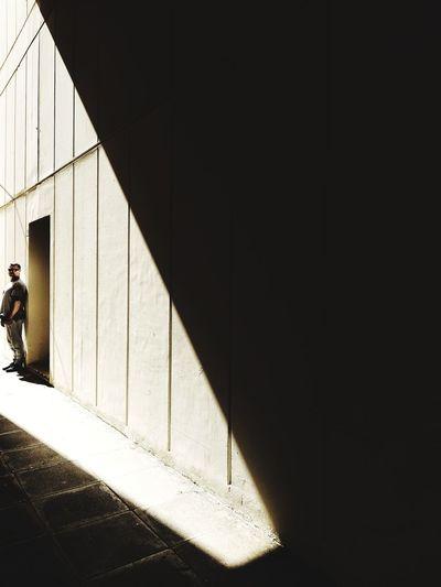 Shadow of woman walking on building wall