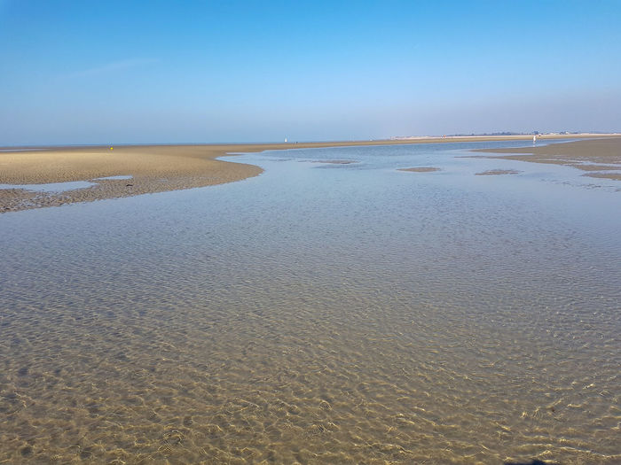 Low Tide Water Low Tide Sea Clear Sky Beach Sand Blue Sunny Summer Tide Coastal Feature Horizon Over Water Wave Shore Coastline Coast Rippled Sandy Beach Seascape