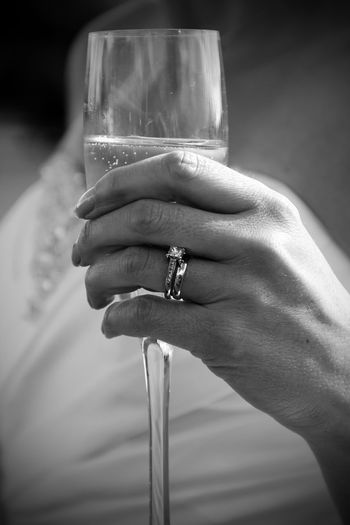Bride Bubbly Champagne Close-up Day Drink Focus On Foreground Freshness Holding Human Body Part Human Finger Human Hand One Person Outdoors People Real People Refreshment Rings Wedding Wedding Day Wedding Dress