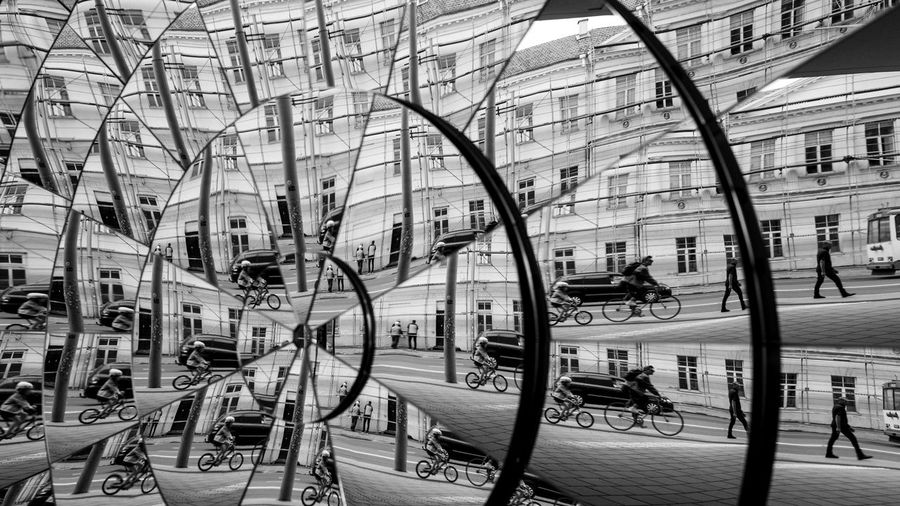 Reflection of people on glass in city