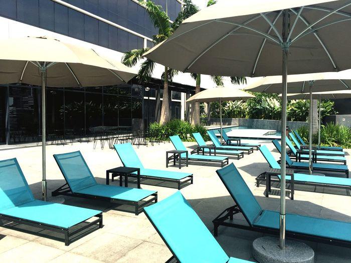 Turquoise Luxury Suntan Singapore Poolside