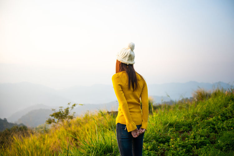 One Person Three Quarter Length Scenics - Nature Plant Beauty In Nature Leisure Activity Nature Real People Standing Sky Clothing Lifestyles Adult Women Landscape Rear View Mountain Environment Tranquility Outdoors