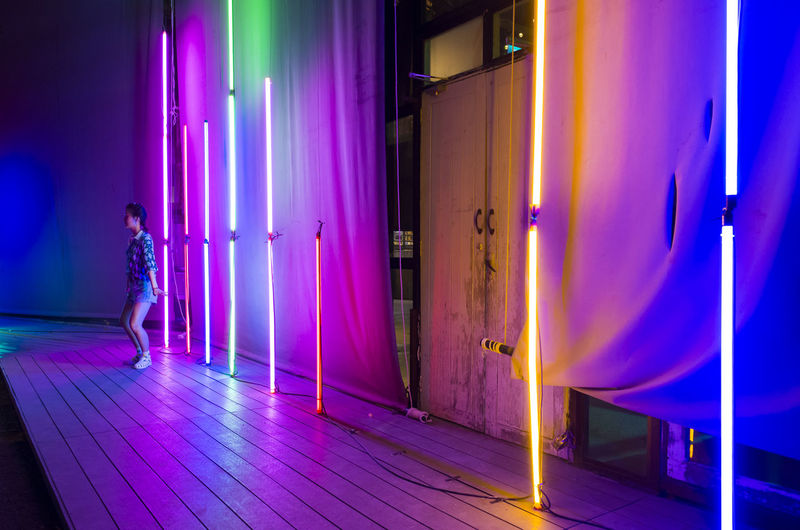 Illuminated Night Pink Color Purple One Person Real People Full Length Architecture Lighting Equipment Lifestyles Women Standing Leisure Activity Blue Building Indoors  Adult Multi Colored Entrance Flooring Nightlife
