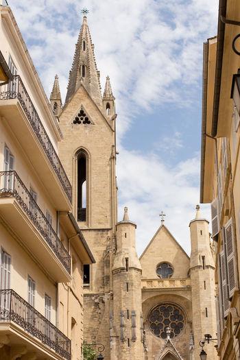 Exterior of historic church against blue sky