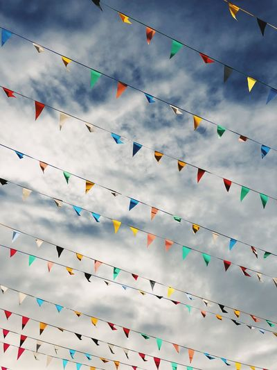 flags Sky Cloud - Sky Celebration Multi Colored Nature Decoration No People Day Large Group Of Objects Flag Bunting Event Low Angle View Religion Environment Outdoors Belief Mountain Wind Blue