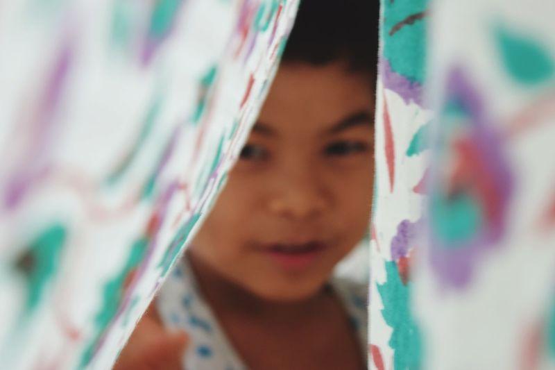 Close-Up Of Boy Seen Through Fabric