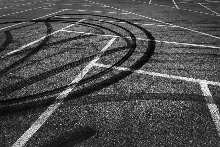 Burnout Asphalt Competition Court Curve Day Dividing Line Focus On Shadow Healthy Lifestyle High Angle View Nature No People Outdoors Pattern Road Shadow Sign Sport Sports Race Street Sunlight Transportation