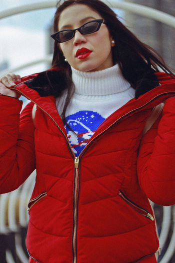 Red, 2018 Lifestyles Front View Red Real People One Person Beautiful Woman Leisure Activity Young Women Young Adult Fashion Beauty Adult Jacket Lipstick Make-up Women Waist Up Day Hair Outdoors Hairstyle Warm Clothing Fashion Red Retro
