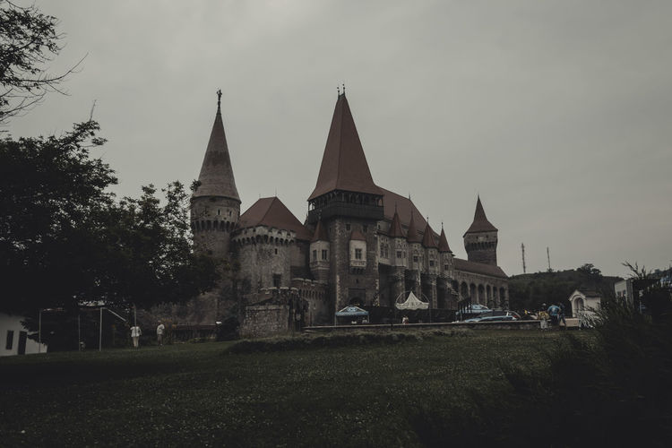Architecture Building Exterior Built Structure Castle Clear Sky Day Façade Famous Place History Hunedoara Lawn Medieval No People Outdoors Religion Sky Spire  Spirituality Tourism Tower Transylvania Travel Destinations Tree