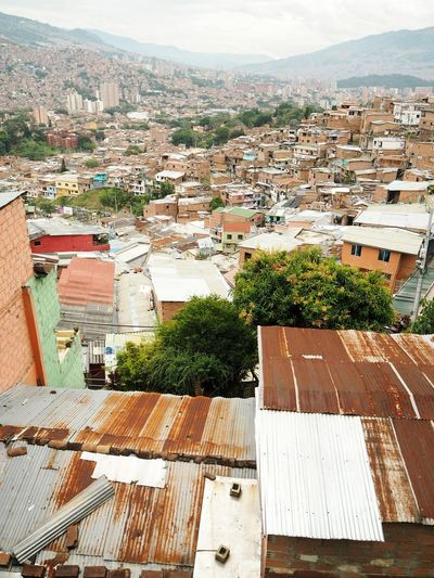 Poverty Comuna 13 Favela Overpopulation Population Dense EyeEm Selects Cityscape City Tree Roof Mountain Residential Building High Angle View House Sky Architecture TOWNSCAPE Rooftop Housing Settlement Human Settlement Crowded Residential District