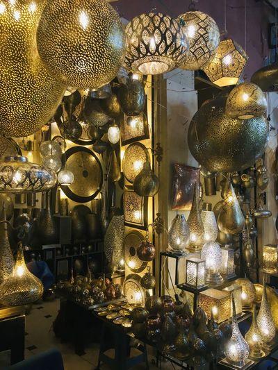 Illuminated lanterns hanging on christmas lights