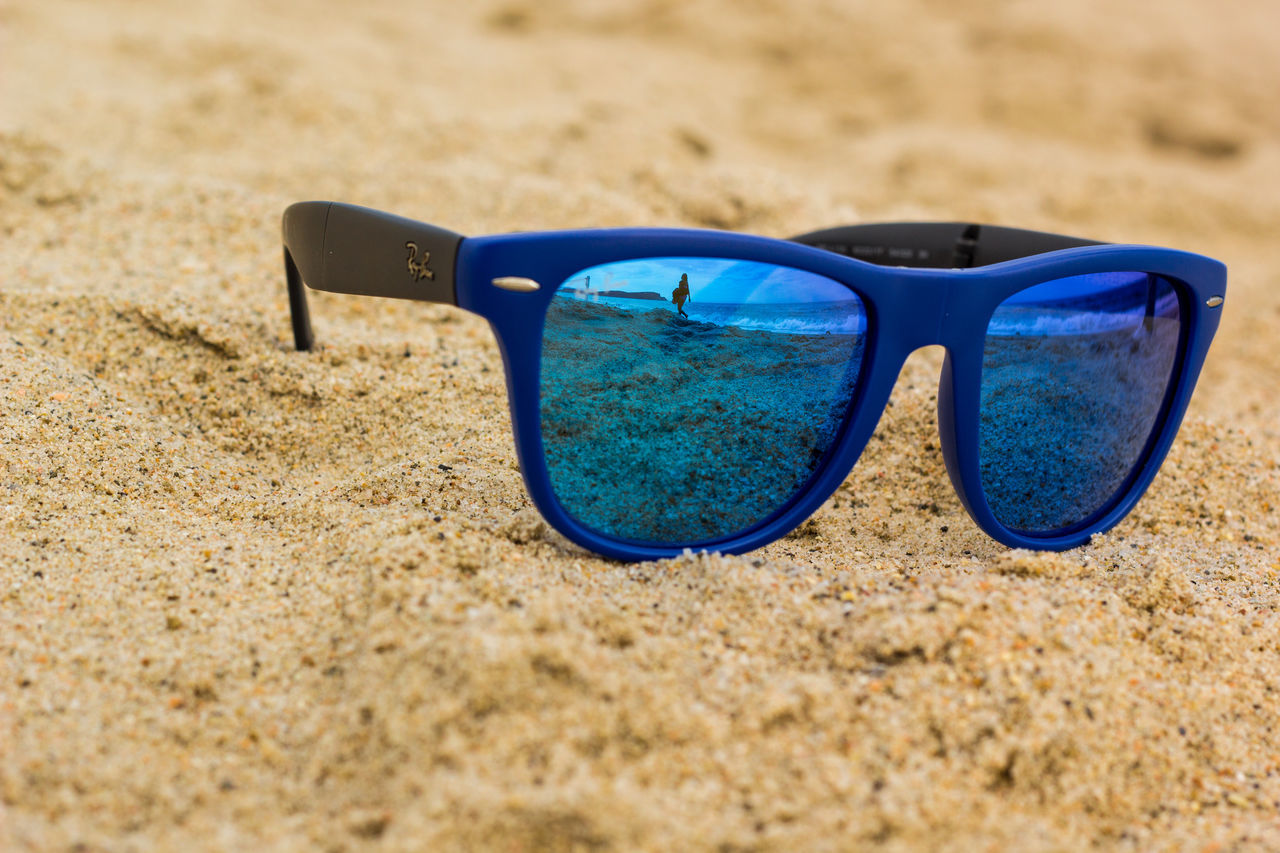 sunglasses, sand, eyewear, eyeglasses, vision, beach, still life, towel, eyesight, cool, summer, glasses, no people, day, outdoors, close-up, nature, reading glasses