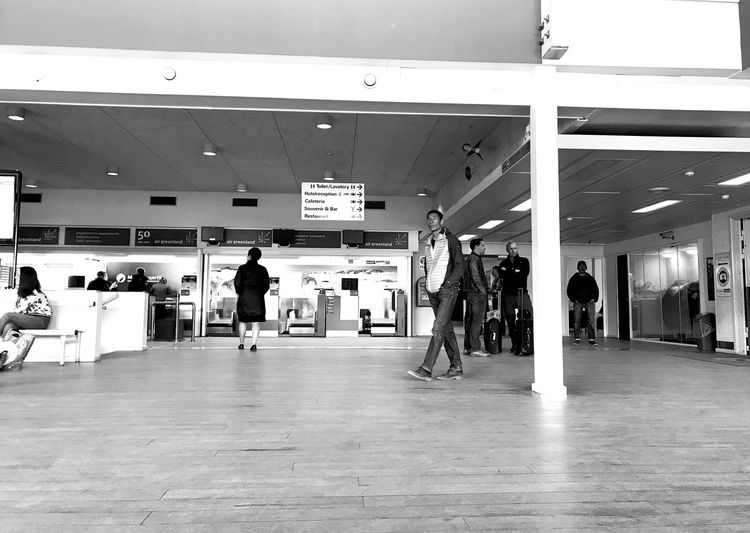 Waiting to board the plane, that was delayed in NUUK!!!! Don't go to NUUK! Always bad weather! Black & White Black & White Photography Waiting Waiting For The Plane Airport Black And White Black And White Photography Black&white Blackandwhite Group Of People Indoors  Monochrome People Real People Terminal Travel