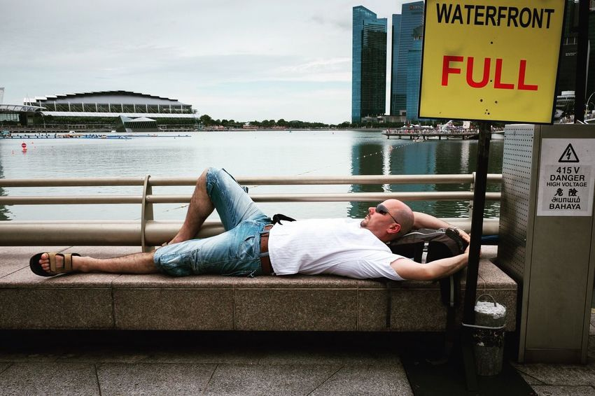 Snaps @ Merlion Singapore Full Length Casual Clothing Lying Down Lifestyles One Person Relaxation People City Outdoors Day Sky EyeEm Best Shots Week On Eyeem Streetphotography Street Photography Streetphoto_color Fujifilm Fujifilm X70 Singapore Streets