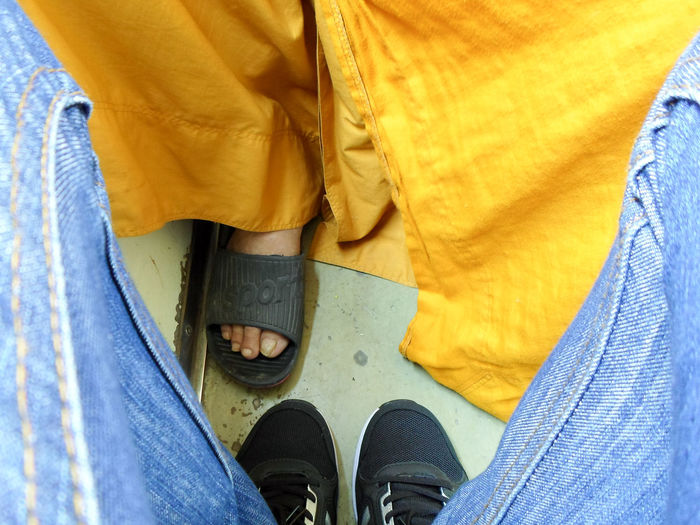 Blue Body Part Casual Clothing Denim High Angle View Human Body Part Human Foot Human Leg Human Limb Jeans Leisure Activity Lifestyles Low Section Monk  One Person Outdoors Personal Perspective Real People Shoe Standing Textile Unrecognizable Person Yellow