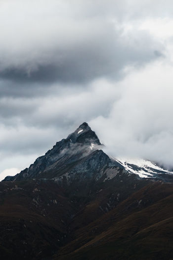 Details of snow capped mountain peak against sky