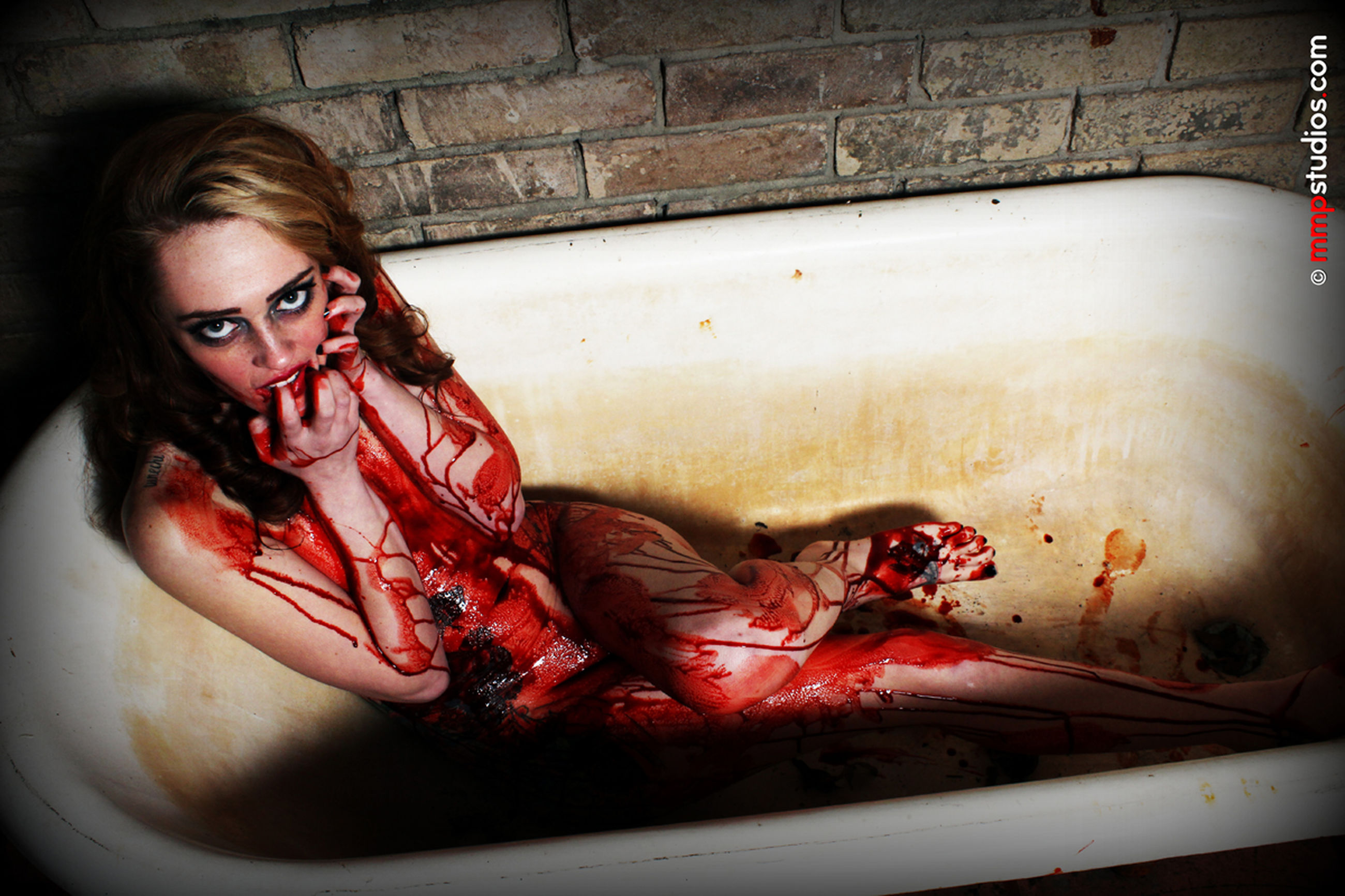 blood, looking at camera, young adult, portrait, one person, indoors, young women, real people, women, lifestyles, make-up, red, fear, horror, headshot, leisure activity, spooky, sitting, aggression, human blood