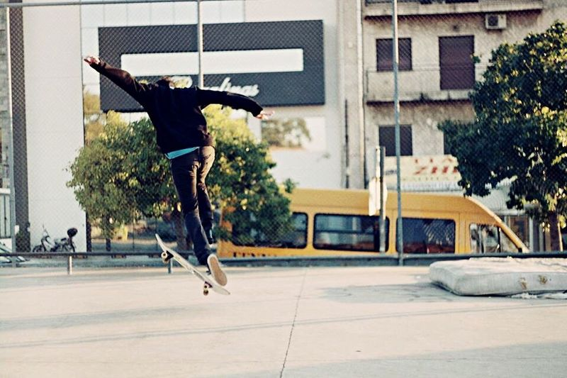 Full Length Jumping Mid-air RISK Skill  Lifestyles Skateboarding Skateboard Casual Clothing Vitality Performance Enjoyment Candid Stunt Fun Young Adult Built Structure Road Cheese! Pic Of The Day Shadows & Lights Chilling Afternoon Royal Skatelife