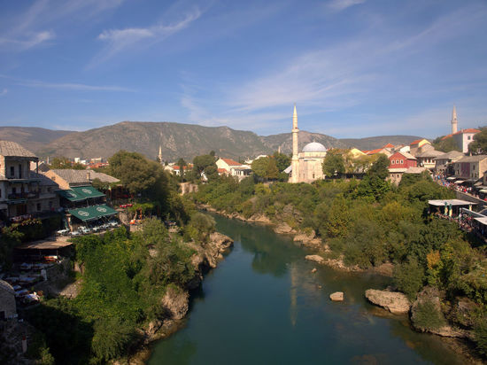 View from the bridge in mostar Bosnia And Herzegovina Mostar Mostar Bosnia Mostar Bridge Architecture Bosnia Bridge Building Exterior Built Structure City Day History House Mountain Mountain Range Nature No People Outdoors Sky Town Travel Destinations Water Waterfront