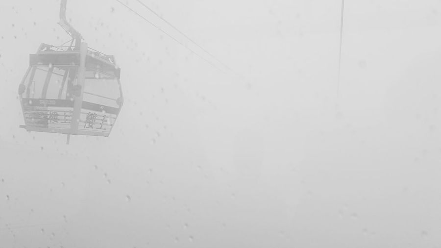 Can not go back, can not move forward Copy Space Architecture Built Structure No People Outdoors Exterior Geometric Shape Full Frame Mountain Tall - High White Background Storm Cloud Storm Stormy Weather Cable Car HongKong Nongping360 Hongkong Afraid Of Height