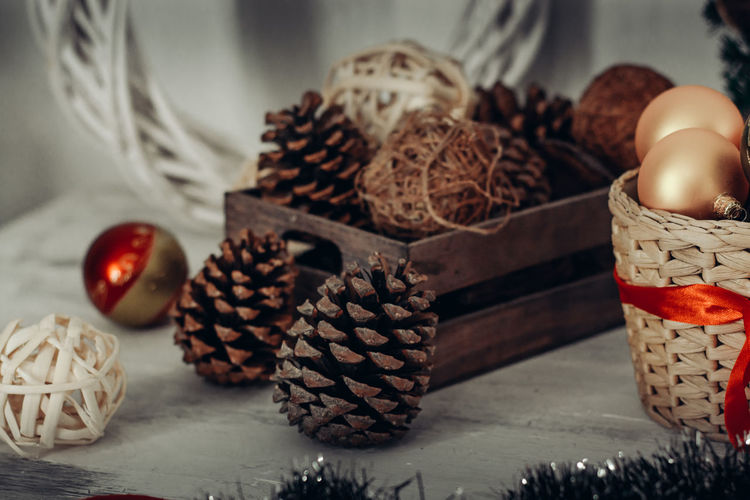 Food And Drink Food Indoors  No People Still Life Close-up Table Basket Freshness Container Egg Selective Focus Focus On Foreground Holiday Wicker Celebration Wood - Material Pine Cone Art And Craft NewYear Christmas Christmas Decoration Balls Winter